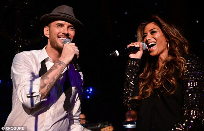 Matt and Nicole Scherzinger performing a duet at Cafe De Paris
